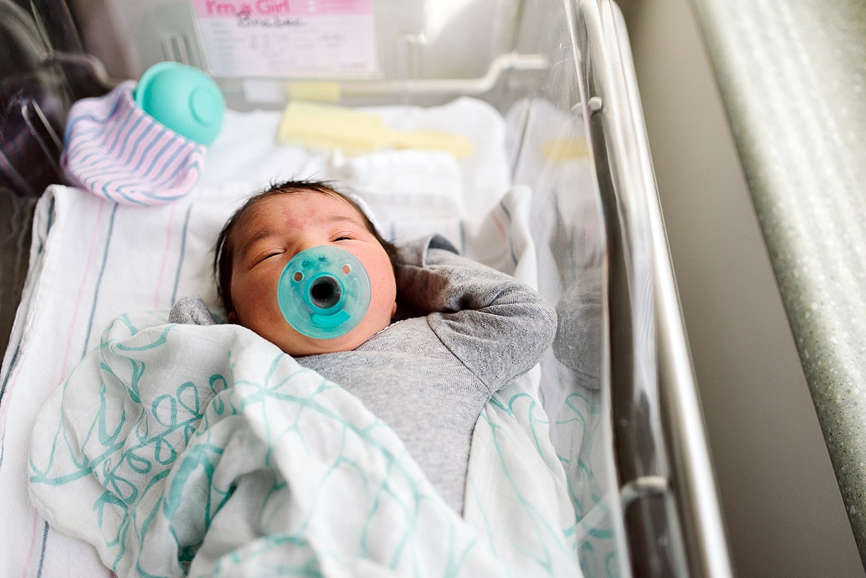 picture of a baby in a hospital bassinet by Bjorna Hoen
