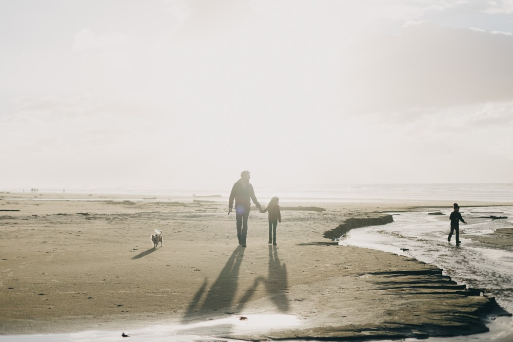 picture of family walking on Oregon caost beach by k dimoff photography