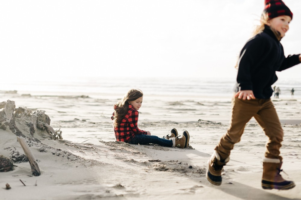 picture of girl sitting on Oregon coast beach by k dimoff photography