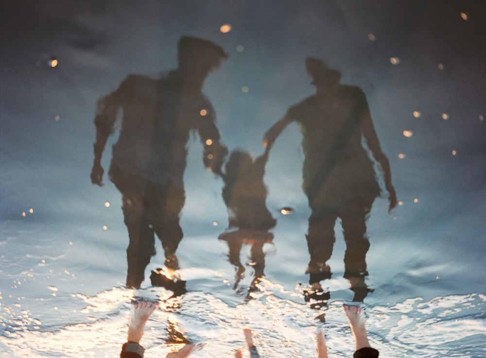 reflection image of family by photographer samantha kelly