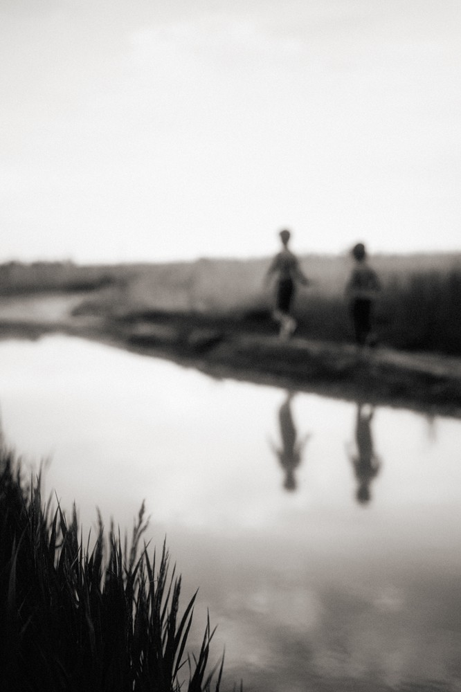 two boys reflection in black and white by photographer steven stanton