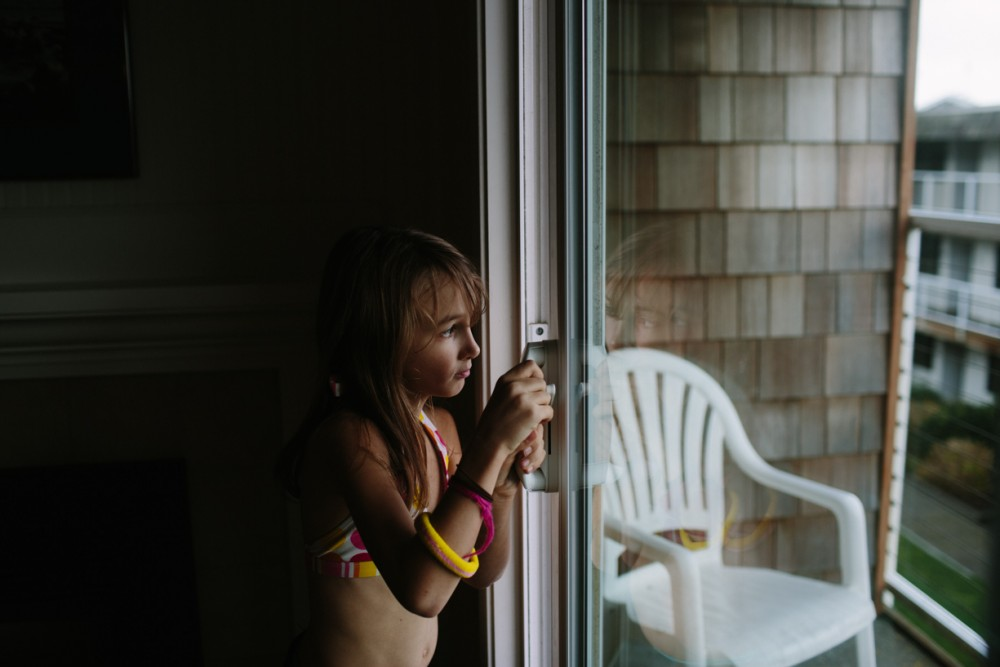 11 picture of girl at hotel room window in cannon beach by photographer shelby brakken