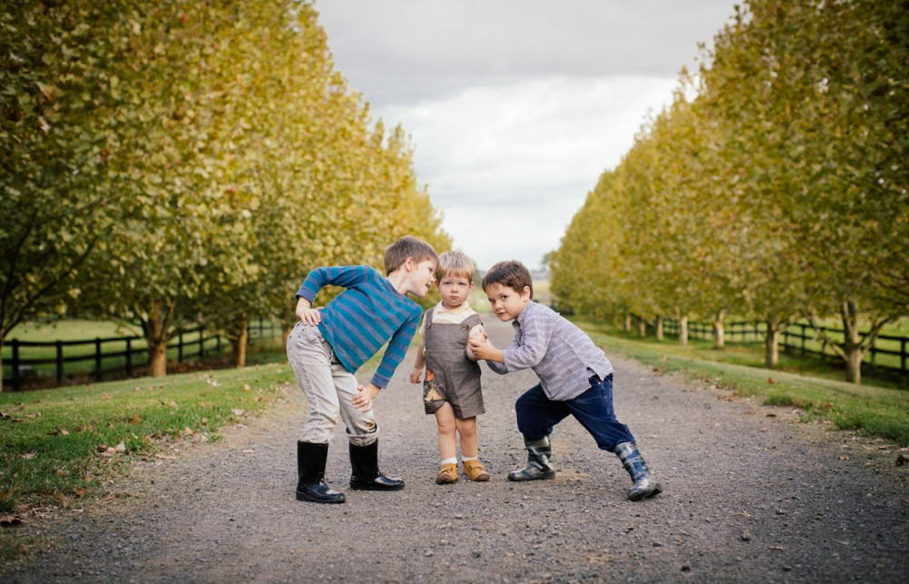 12 image of three young brothers goofing around on dirt road by sheridan nilsson