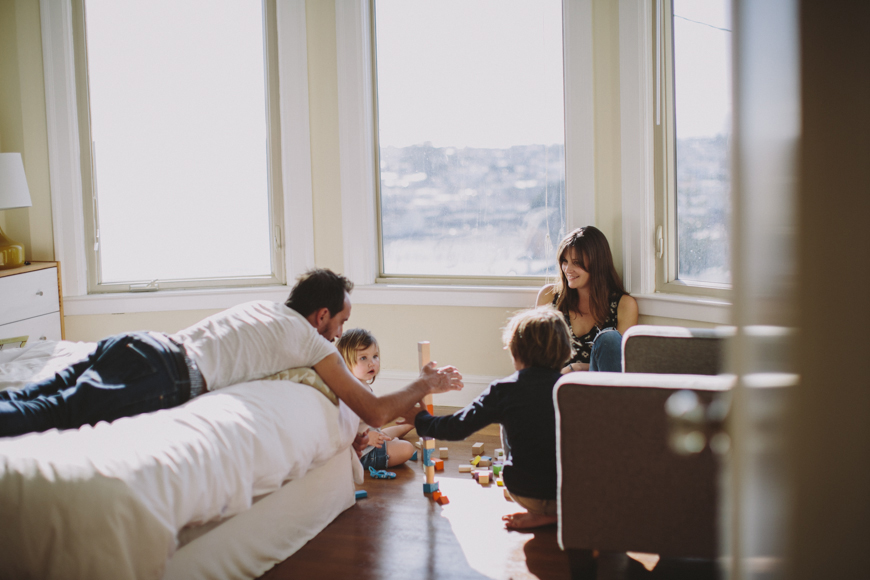 12 photo of family of four playing blocks in San Francisco home by Rachelle Derouin