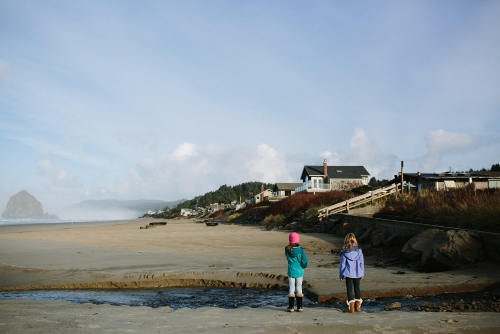 12 picture of girls on cannon beach with houses by photographer shelby brakken