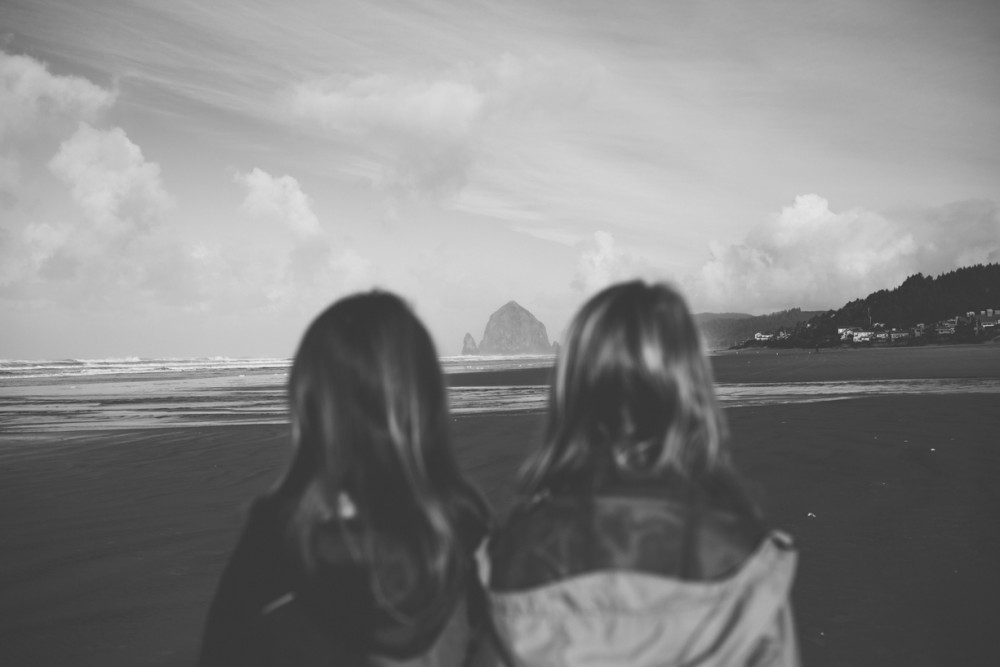 14 picture of two girls looking at haystack rock on cannon beach by photographer shelby brakken