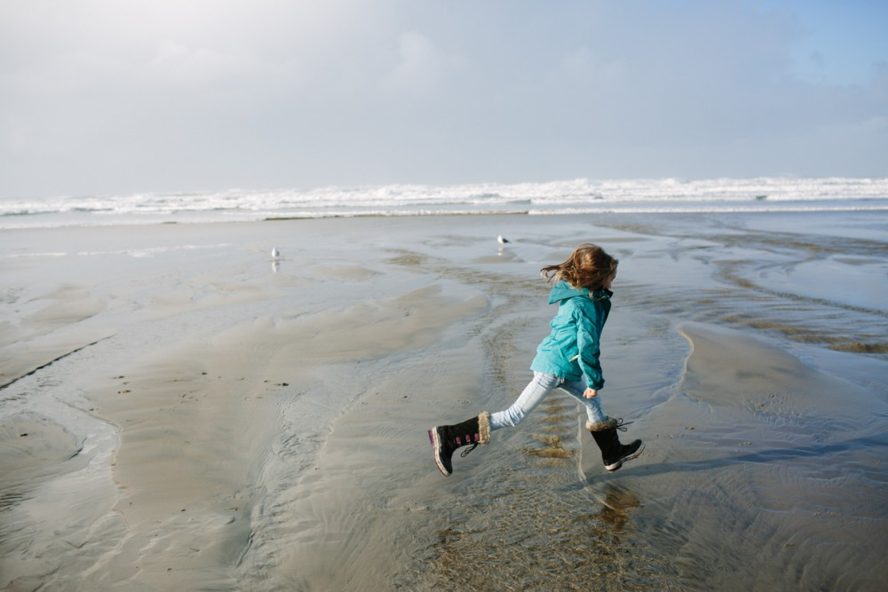 15 picture of girl running through water on cannon beach by photographer shelby brakken