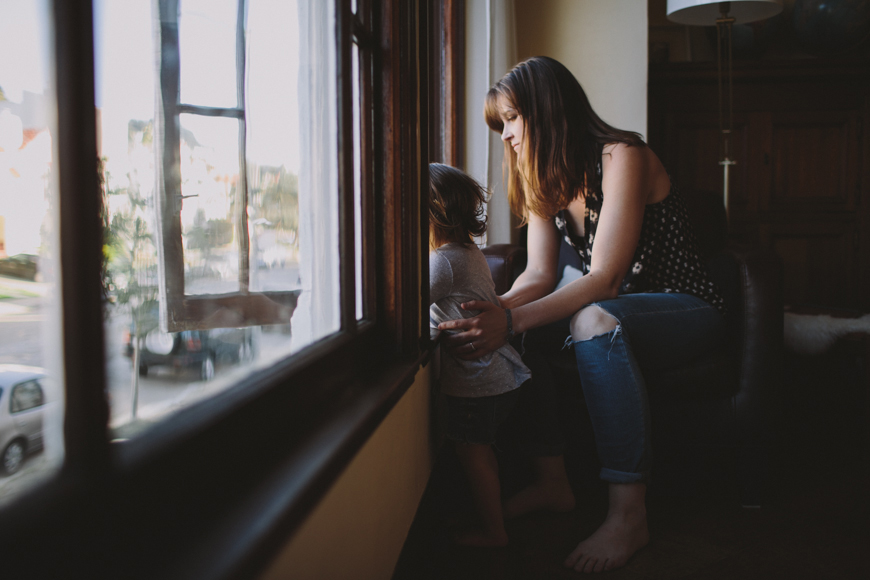 16-photo-of-mother-holding-daughter-as-she-looks-out-open-window-by-Rachelle-Derouin.jpg