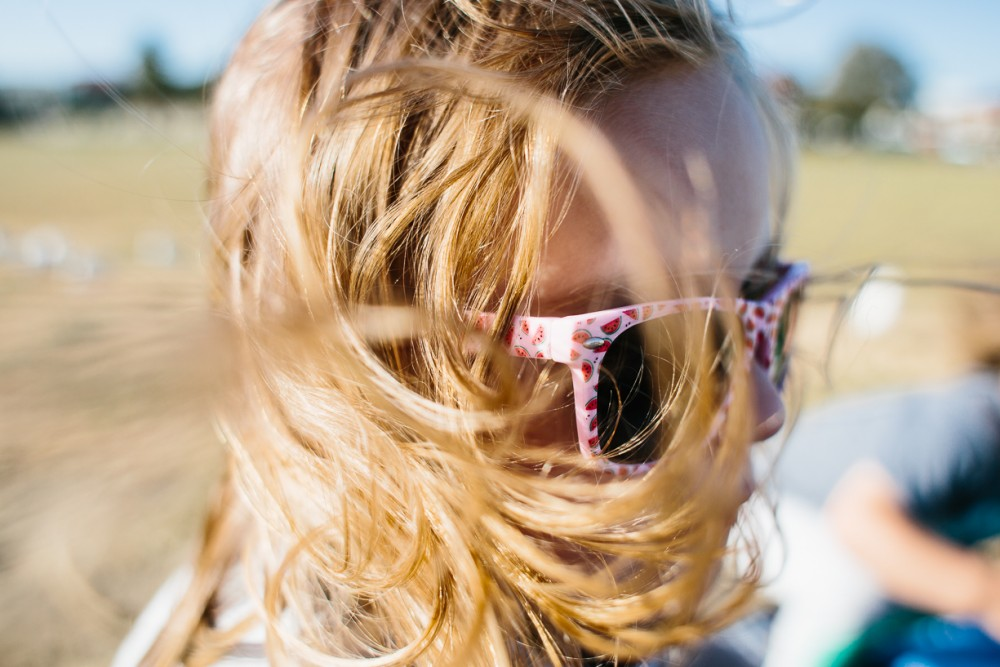 17 image close up of blonde young girl with pink watermelon sunglasses by Natasha Kelly