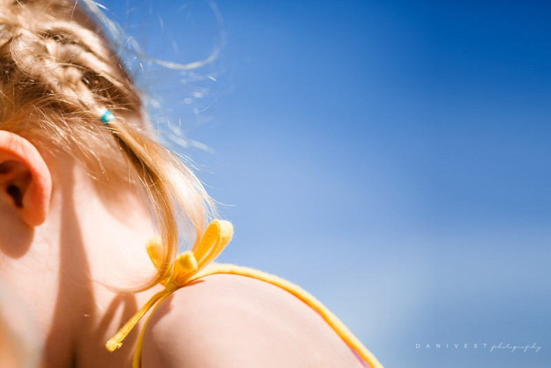 1_picture of young girl hair and shoulder yellow strap blue sky by dani vest