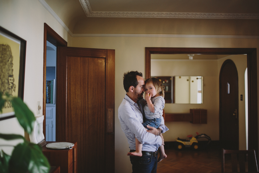 3 photo of father holding toddler daughter in San Francisco home by Rachelle Derouin 8