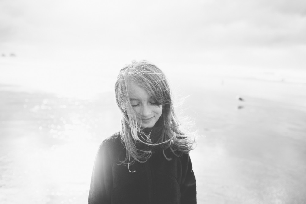 3 picture of girl with wind in hair by photographer shelby brakken