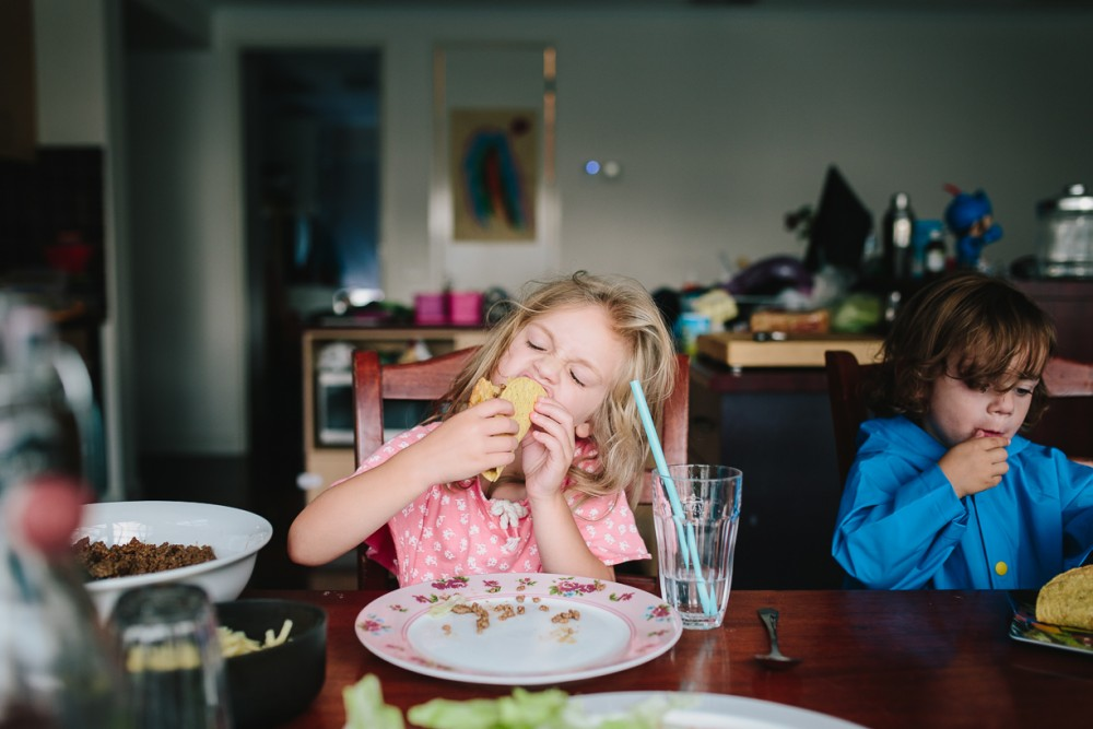 4 picture of young girl eat mexican food at home with brother at table by Natasha kelly