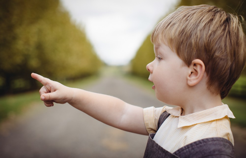 5 picture of young boy on road close up pointing to left by sheridan nilsson