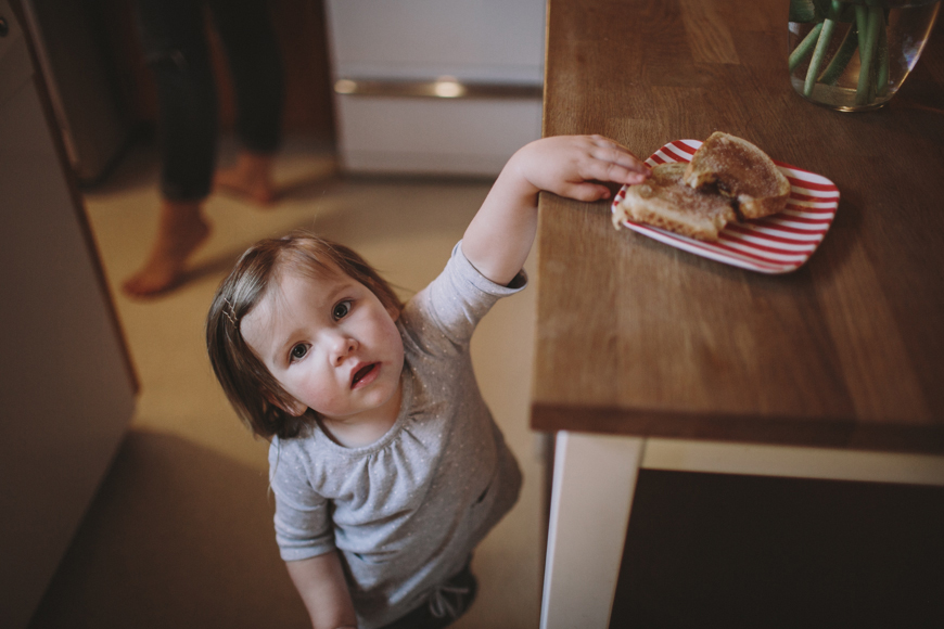 7 photo of toddler girl reaching for food by Rachelle Derouin