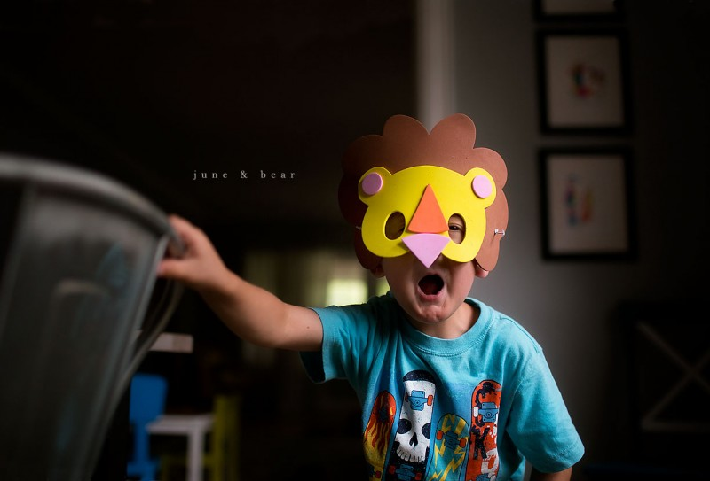 7 young boy with yellow lion mask in house by June&Bear ColorCollaborative