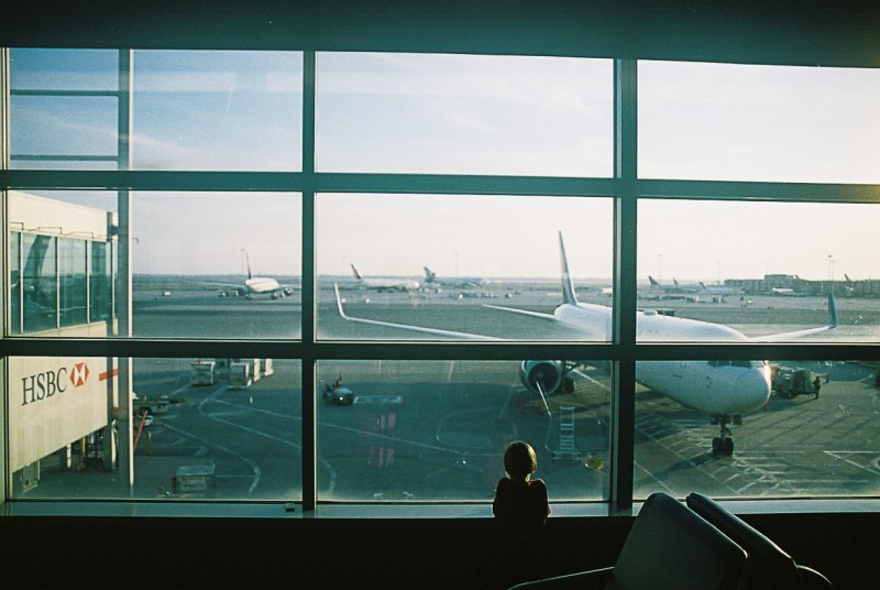 9 Child watching airplane in JFK airport in New York City by international film photographer Lea Jones