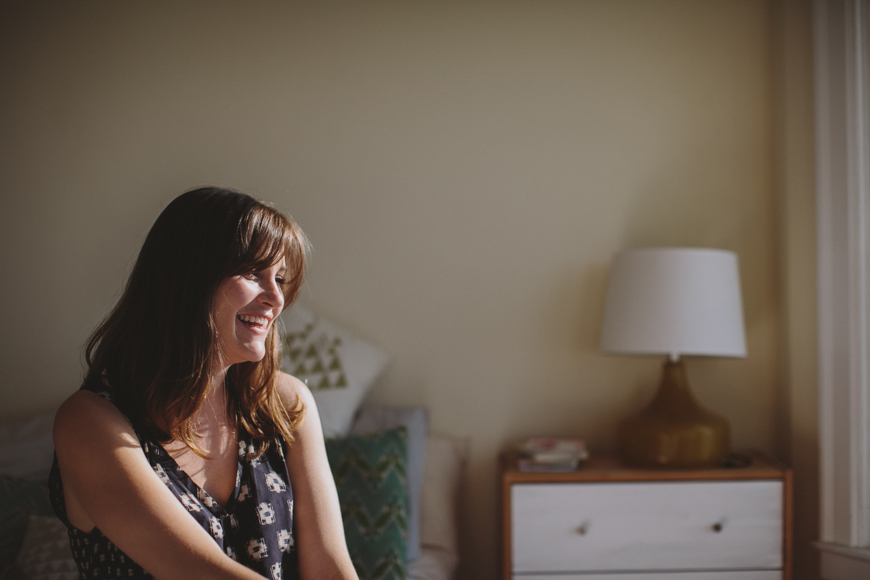 9 photo of young mother laughing in San Francisco home by Rachelle Derouin
