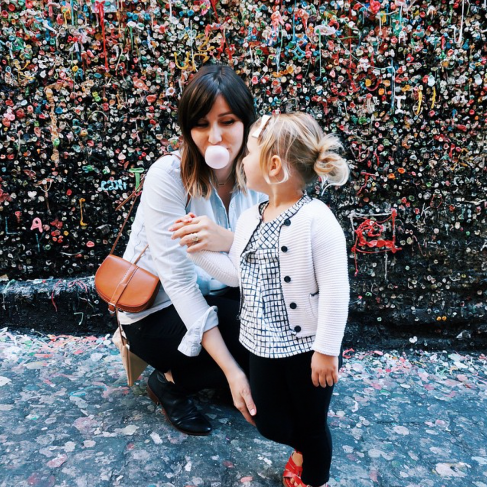 Photo of mom and daughter blowing bubbles in gum by Angela Hardison