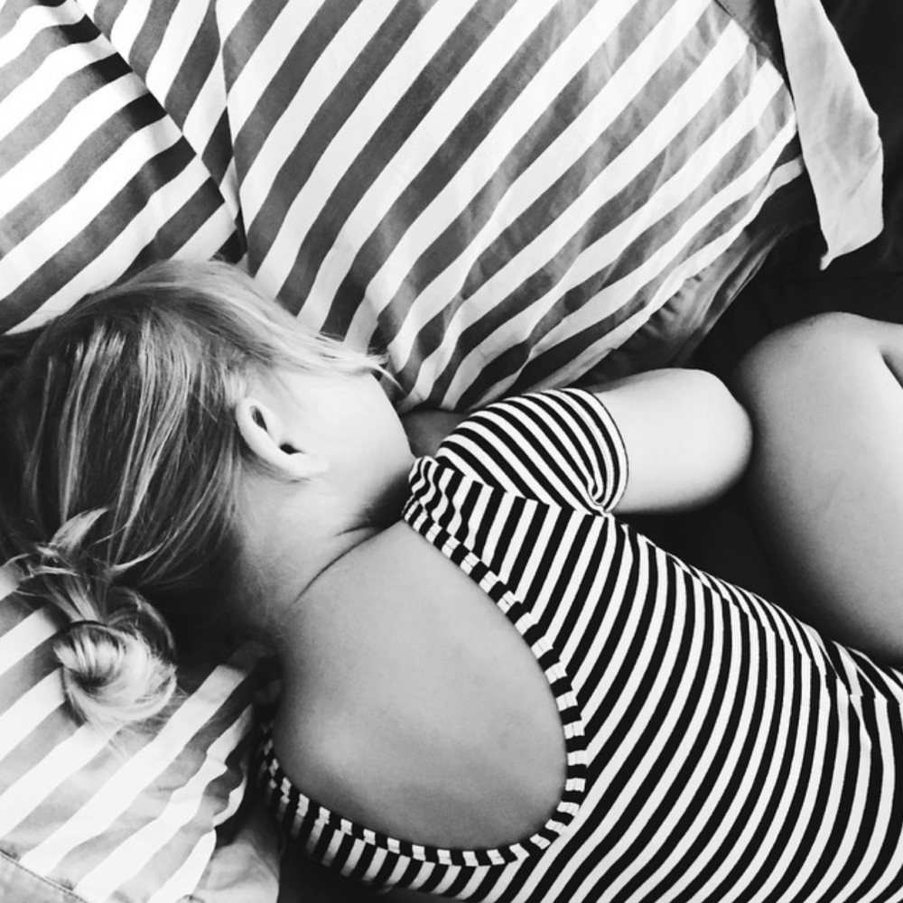 Picture of little girl sleeping in stripes by Angela Hardison