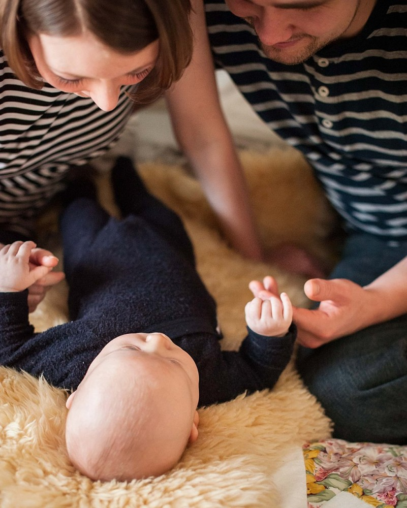 a photo of new parents looking down at their new baby by Fairbanks Alaska photographer Sarah Lewis