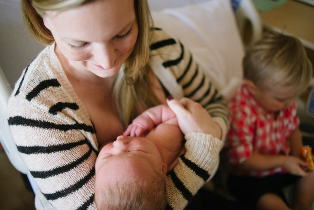 a picture of a mom holding her newborn baby by Phoenix Arizona photographer Pamela Nicole