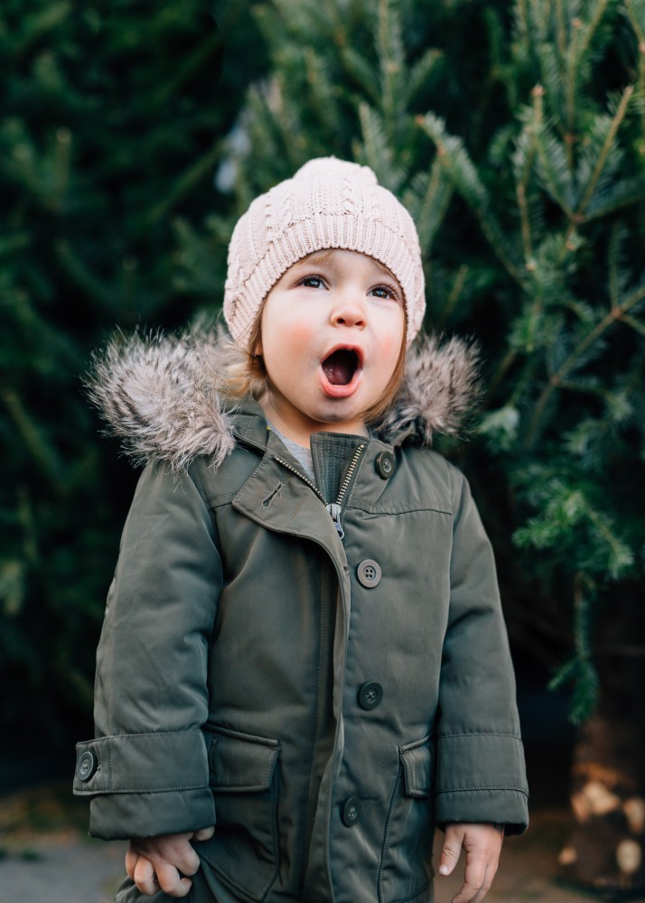little girl in fur parka and knit hat yelling image by photographer nicki sebastian
