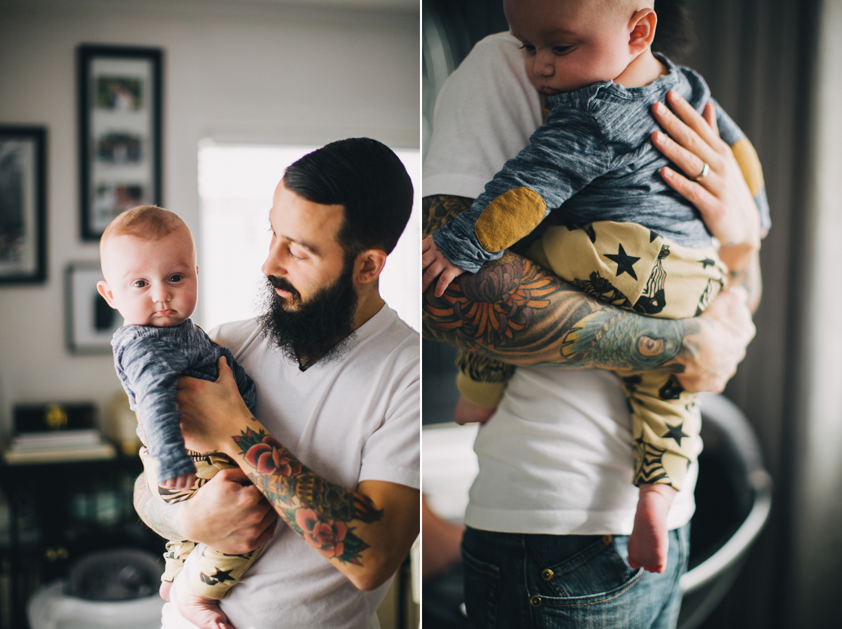 photo of a dad with a tattoo holding his new baby by Philadelphia photographer Parikha Meta