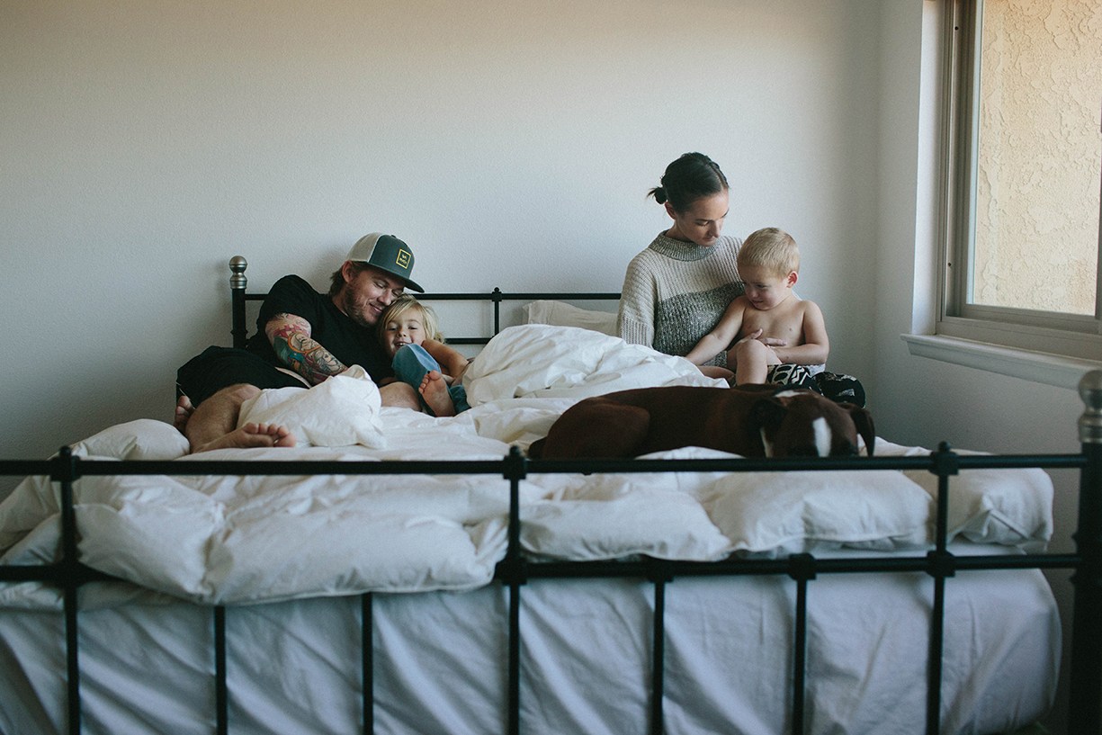 photo of a tender moment in bed with children by the stork and the beanstalk