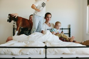 photo of little boy jumping on bed by the stork and the beanstalk