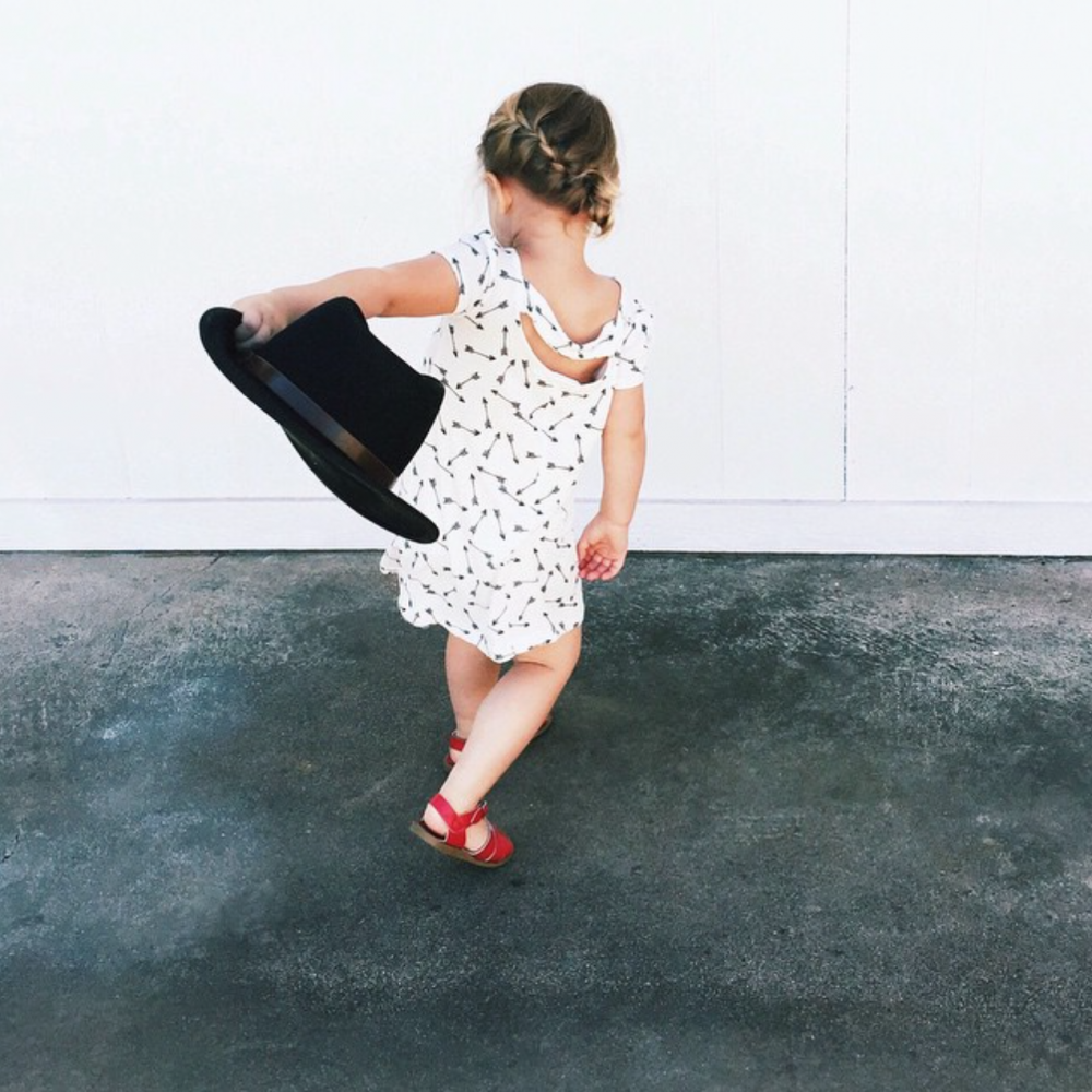 photo of little girl dancing with hat by Angela Hardison