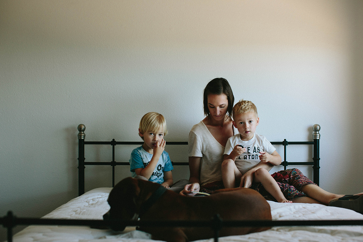 photo of mom with her boys in bed by the stork and the beanstalk