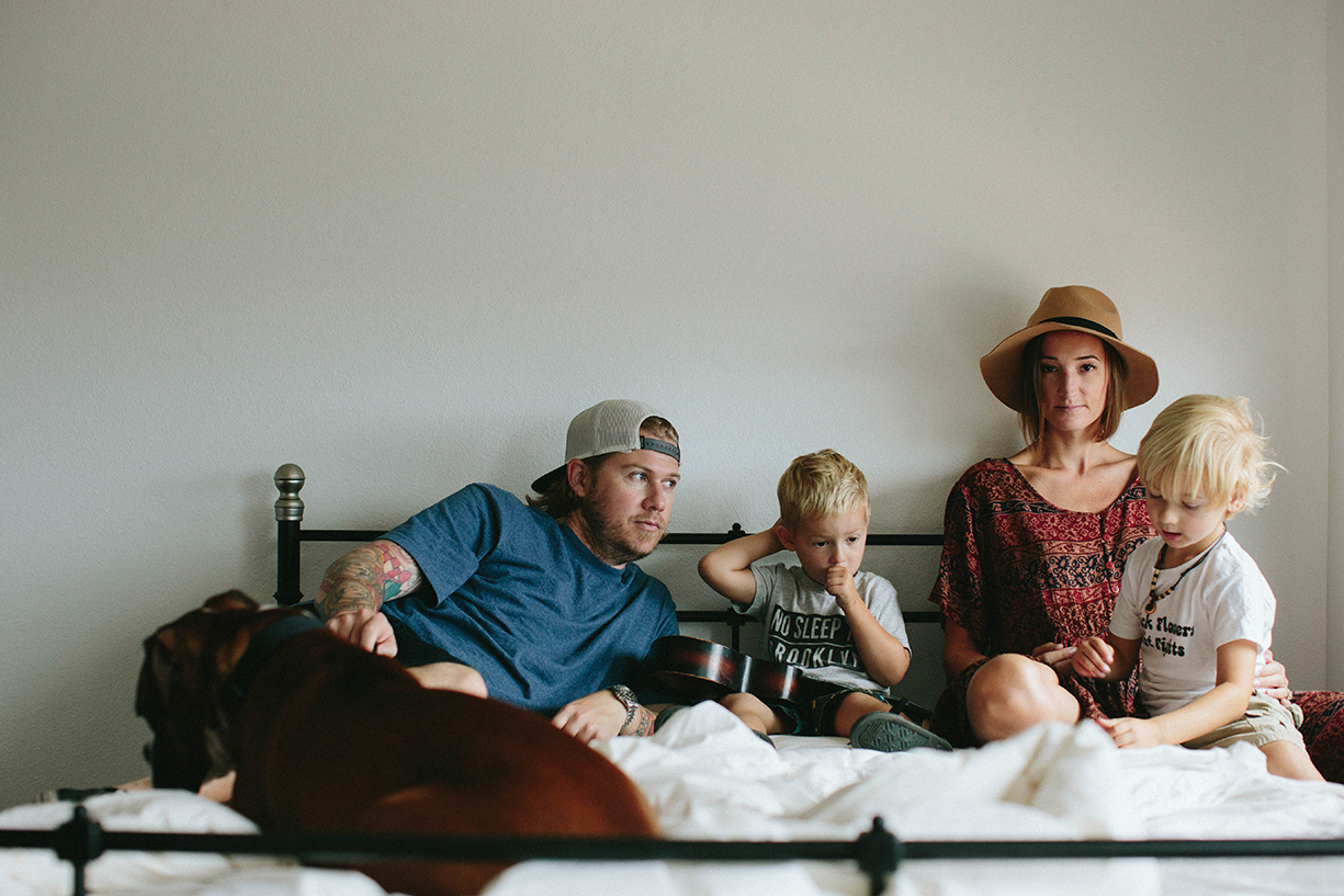 picture of stylish family in bed by the stork and the beanstalk