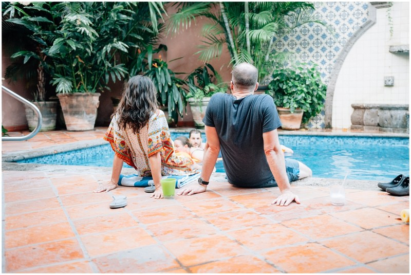 10 Couple sits poolside in Bucerias Mexico by photographer Danielle Hatcher