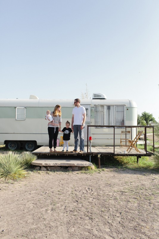 12 family in front of green camper in malfa by texas photographer brooke schwab