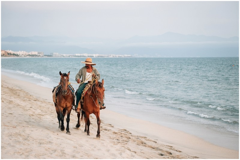 13 Man rides one horse and ponies another on a Mexican beach by photographer Danielle Hatcher