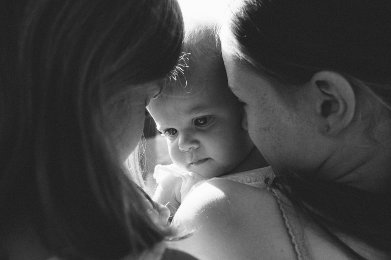 13 Snuggling a baby in B&W by texas photographer brooke schwab