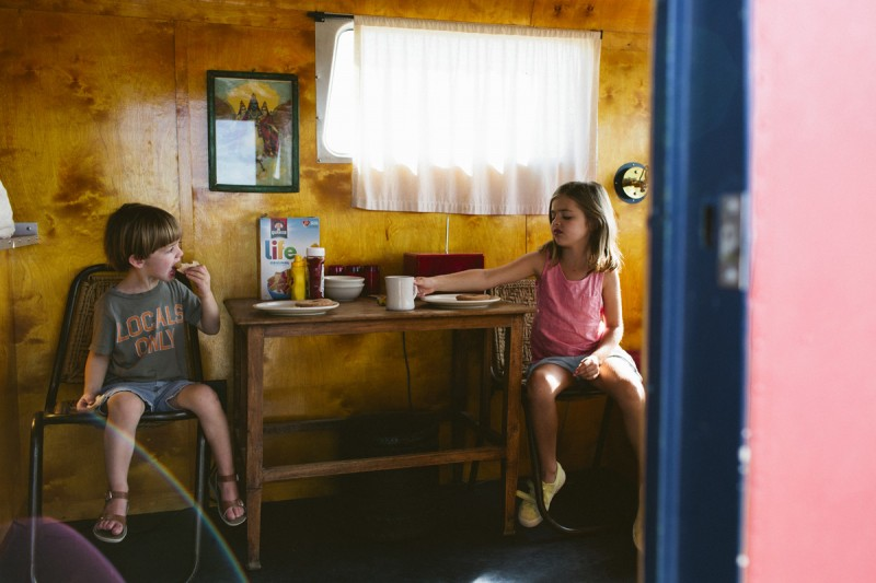 14 kids eat breakfast in a camper in Malfa by texas photographer brooke schwab
