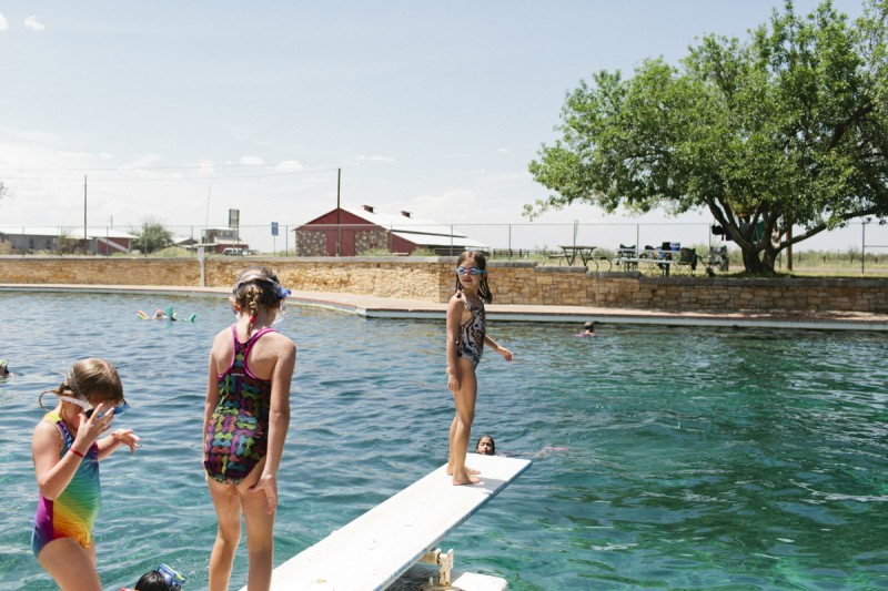 15 Kids stand on diving board in malfa by texas photographer brooke schwab