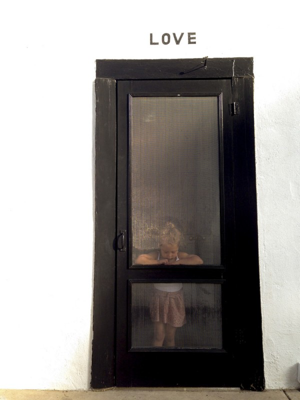 23 Girl framed in doorway by texas photographer brooke schwab