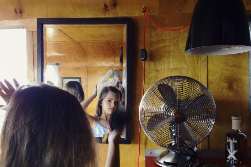 26-girl-fixes-hair-in-mirror-by-texas-photographer-brooke-schwab
