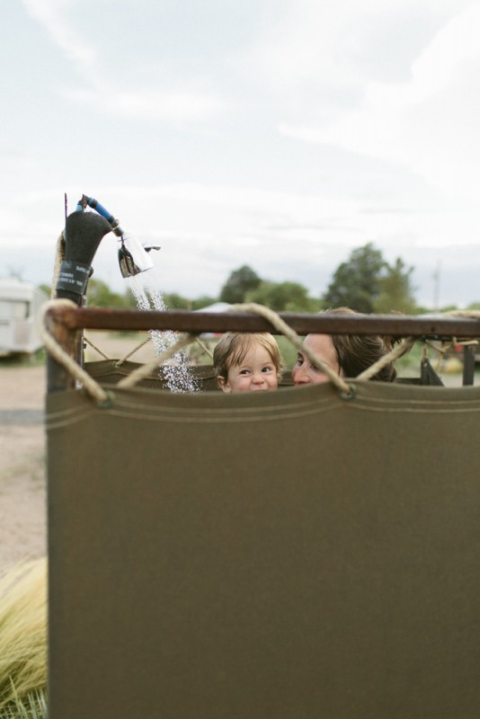 4 baby with mom in outdoor shower by texas photographer brooke schwab