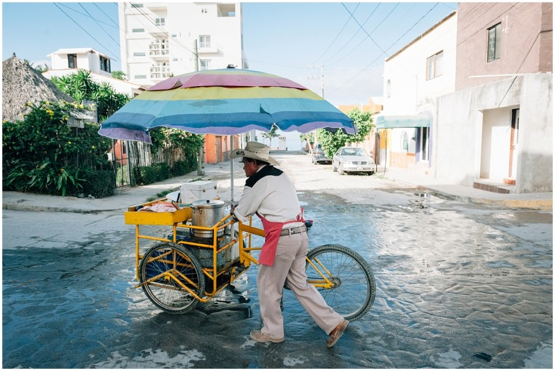 6 Photo of man moving wares by bike by photographer Danielle Hatcher