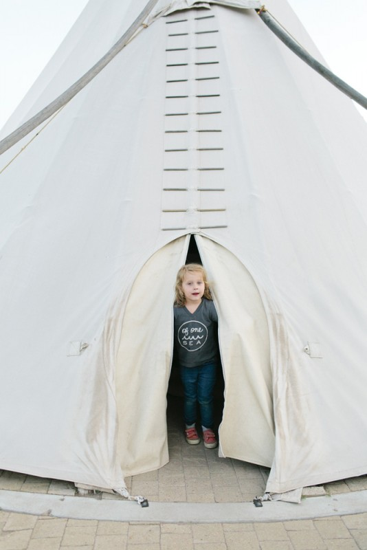 8 girl peeks out of tepee in malfa by texas photographer brooke schwab