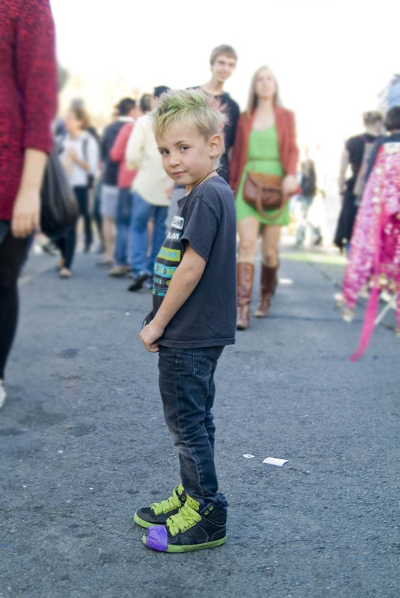 Photo of little boy with green hair and shoes by Erica Tashiro