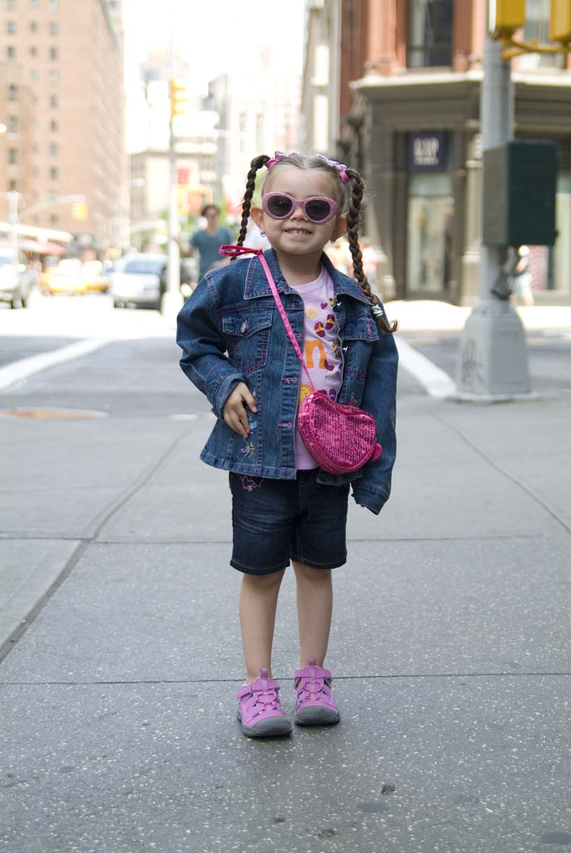 Picture of little girl in pink and pigtails by Erica Tashiro