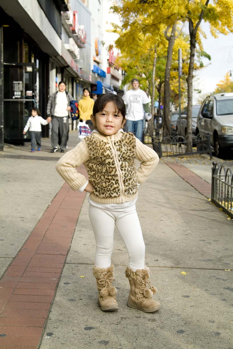 photo of sassy little girl on street by Erica Tashiro