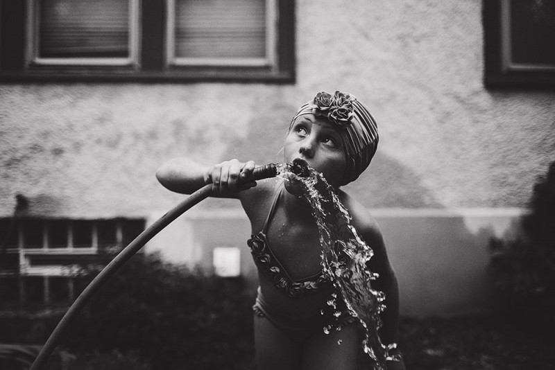picture  of boy drinking from hose by photographer sarah swanson