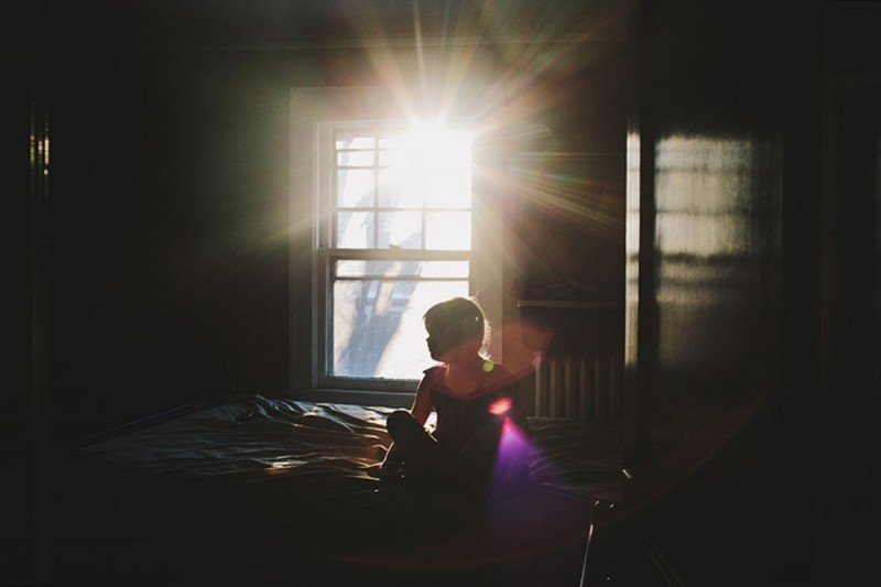 photo of girl in purple dress inside room with sun shining through window by photographer sarah swansonn's image of girl in purple dress inside room with sun shining through window