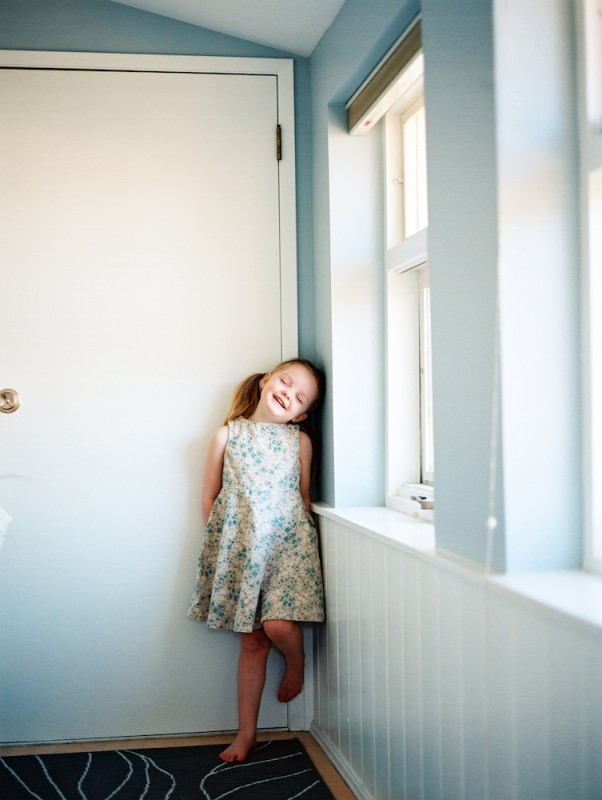rebecca siewert's film image of little girl in vintage floral dress against wall